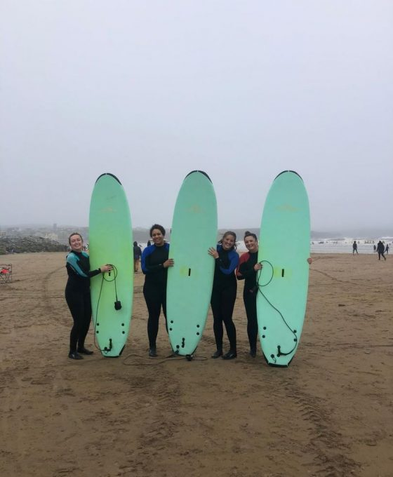 Surfing in Lahinch with Ireland Chauffeur Travel